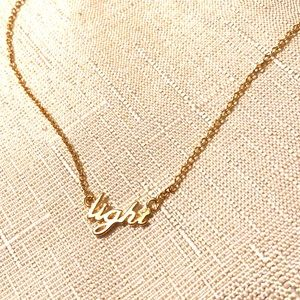"Dainty ""Light"" Necklace in gold tone"